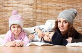 pic of knitwear  - Young mother and her kids dressed in warm knitwear for cold weather - JPG