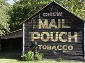 image of tobacco barn  - A country baqrn with a Mail Pouch Tobacco sign on it.