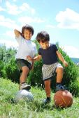 Two Little Kids With Basketball And Football