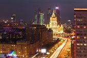 MOSCOW - MAY 12: New Arbat Street, Hotel Ukraine and Business complex Moscow-City at night, on May 1