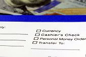 Bank savings and withdrawal slip with US currency