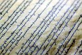 image of scribes  - Old grunge paper with elegant handwriting on black background  - JPG