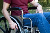 picture of crippled  - Man disabled by an accident sits in a wheelchair outside - JPG