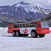 Snowcoach goes to Athabasca Glacier surface.