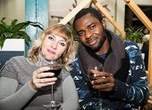 Portrait Of Happy Couple: Black Man And White Woman With Glass Of Wine At Party