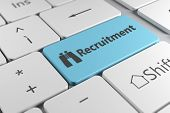 foto of recruitment  - Recruitment directly using a blue button with binoculars icon in a elegant keyboard - JPG