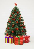 Christmas tree with decorations on gray background