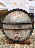 An old painted wine barrel in Chateau de Pommard, France