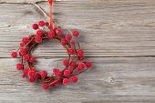 Christmas Wreath From Red Berries On Wooden Background
