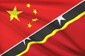 Series Of Ruffled Flags. China And Federation Of Saint Christopher And Nevis.