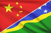 Series Of Ruffled Flags. China And Solomon Islands.