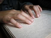 stock photo of braille  - Fingers and braille - JPG