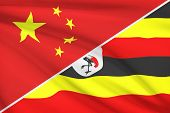 Series Of Ruffled Flags. China And Republic Of Uganda.