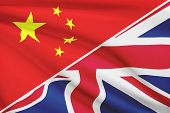Series Of Ruffled Flags. China And United Kingdom Of Great Britain And Northern Ireland.