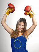 Success Woman Celebrating For Her Succes With The Flag Of Europe On Her Shirt