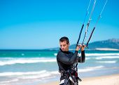 young athlete going to kite surfing training
