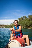 image of canoe boat man  - Handsome young man on a canoe on a lake - JPG