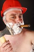 Man  Shave Himself With An Ax