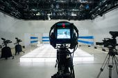 Television studio with jib camera and lights - camera on a crane. Shallow depth of field - focus on