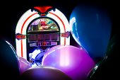 picture of jukebox  - Dark dance room with neon jukebox and party balloons - JPG