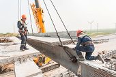 Workers establish bridge span