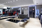 foto of showrooms  - luxury and fashionable brand new interior of cloth store - JPG