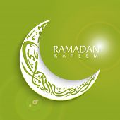 Arabic islamic calligraphy of stylish text arabic islamic calligraphy of text Ramadan Kareem with crescent moon on green background.