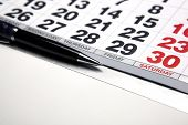 Wall Calendar With Pen Closeup