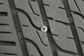 Flat Car Tire With Wood Screw Imbedded In Tread