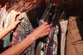Woman Browsing Clothes At Market