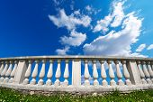 Balustrade Pillars On A Cloudy Sky