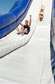 Couple Goes Down Giant Slide In Obstacle Race Challenge