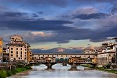 stock photo of arch foot  - he Ponte Vecchio is a Medieval arch bridge over the Arno River in Florence Italy