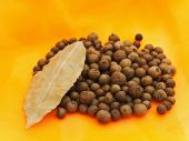 picture of bay leaf  - allspice and bay leaf over orange textile background - JPG