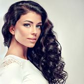 Model brunette with beautiful long curled hair