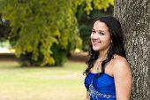 Teen girl wearing her formal Quinceanera dress
