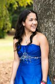 Teen girl wearing her formal Quinceanera dress