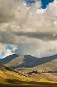 Paraglider In The Sky Of Italy