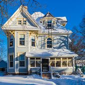 An older north American home after a snow storm.
