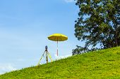 pic of cartographer  - surveying the area by geodesy under blue sky - JPG