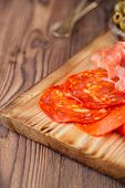 Platter of serrano jamon Cured Meat, , chorizo and olives