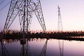 high voltage transmission tower and landscape during sunset