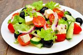 Greek salad in the white plate