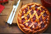 Delicious homemade pie with cowberry jam