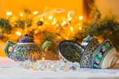 Kettle and bowls, Tajik dishes, Christmas decorations, candles, festively decorated table at Christm