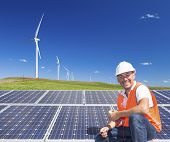 pic of wind-farm  - Sustainable clean energy technician with solar panels and wind turbines - JPG