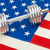 Metal Dumbbell Over Us Flag As Symbol Of Healthy Nation
