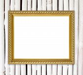 Blank Golden Frame On Bamboo Wall