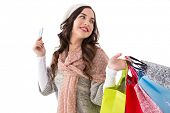 Beauty brunette holding credit card and shopping bags on whit ebackground