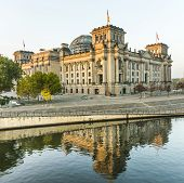 Reichstag (bundestag) With Reflection In Spree River In Berlin